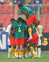 Photo: Steve Bond/Richard Lane Photography.<br /> Cameroun v Zambia. Africa Cup of Nations. 26/01/2008. Andre Bikey (top) joins in the celebrations with Njitap Geremi