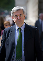 © licensed to London News Pictures. 11/07/2011. Secretary of State for Energy and Climate Change chris huhne leaving the Cabinet Office in Whitehall today (11/07/2011). Photo credit should read Ben Cawthra/LNP