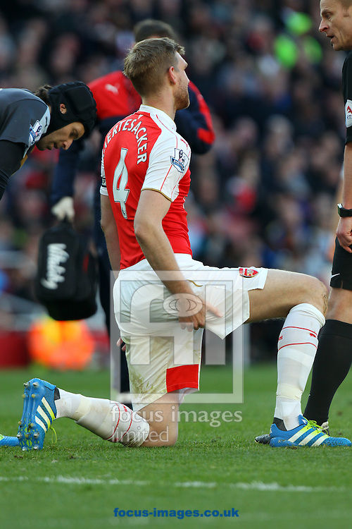 Per Mertesacker of Arsenal has to leave the match with what looks like a hamstring problem during the Barclays Premier League match at the Emirates Stadium, London, UK.<br /> Picture by Paul Chesterton/Focus Images Ltd +44 7904 640267<br /> 30/04/2016