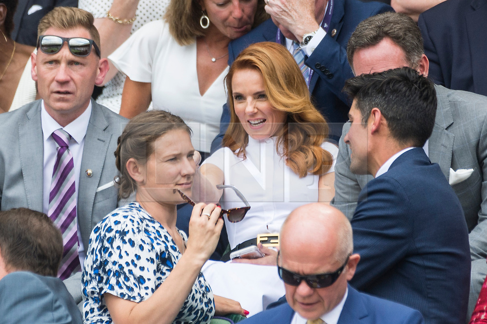 © Licensed to London News Pictures. 05/07/2019. London, UK.  Geri Horner and Christian Horner watch centre court tennis in the royal box on Day 5 of Wimbledon Tennis Championships 2019 held at the All England Lawn Tennis and Croquet Club. Photo credit: Ray Tang/LNP