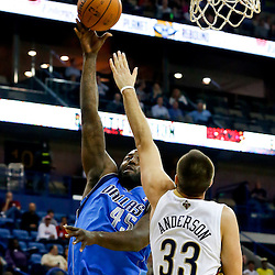 Dec 4, 2013; New Orleans, LA, USA; Dallas Mavericks center DeJuan Blair (45) shoots over New Orleans Pelicans power forward Ryan Anderson (33) during the first quarter of a game at New Orleans Arena. Mandatory Credit: Derick E. Hingle-USA TODAY Sports
