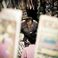 Magazine salesman in Little India, Kuala Lumpur
