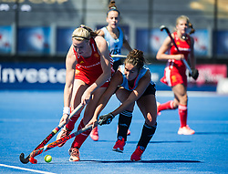 England's Lily Owsley is tackled by an Argentina defender. England v Argentina, Lee Valley Hockey and Tennis Centre, London, England on 10 June 2017. Photo: Simon Parker