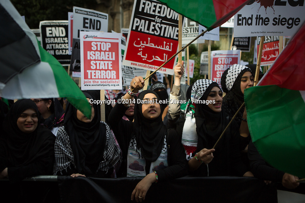 Image ©Licensed to i-Images Picture Agency. 15/07/2014. London, United Kingdom. Demonstration against BBC Israel-Palestine reporting. Female Muslims Demonstrator against Israeli strikes on Gaza shouting in front of the BBC in a demonstration against their way of reporting the conflict. the BBC. Picture by Daniel Leal-Olivas / i-Images
