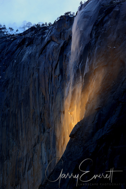 Sun breaking through to light the bottom of Horsetail Falls in Yosemite NP 2017.