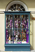 Mardi Gras shop window with traditional masks and souvenirs in Royal Street in French Quarter, New Orleans, USA