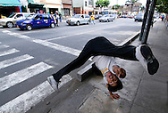 Ángel Trujillo doing somersault at the crossroad between Pierola and Grau in the Barranco district, an upper class area of Lima