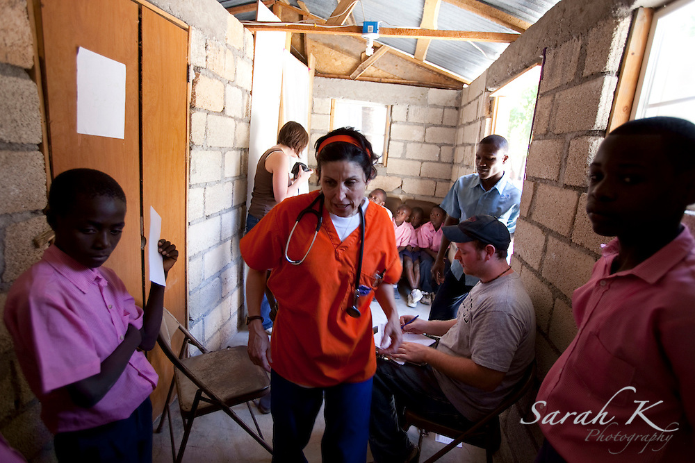 American missionary nurse Charlotte Schmitt takes her vacation days from Florida Hospital in Orlando, Fla., to provide free medical clinics for those who lack health care in Haiti. She has already made two trips this year to the rural mountain of Bayonnais to provide medical care for hundreds of villagers.