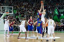Kosta Perovic of Barcelona vs Damir Markota (22) of Olimpija during Euroleague Top 16 basketball match between KK Union Olimpija Ljubljana (SLO) and FC Regal Barcelona (ESP) in Group F, on January 27, 2011 in Arena Stozice, Ljubljana, Slovenia.  (Photo By Vid Ponikvar / Sportida.com)