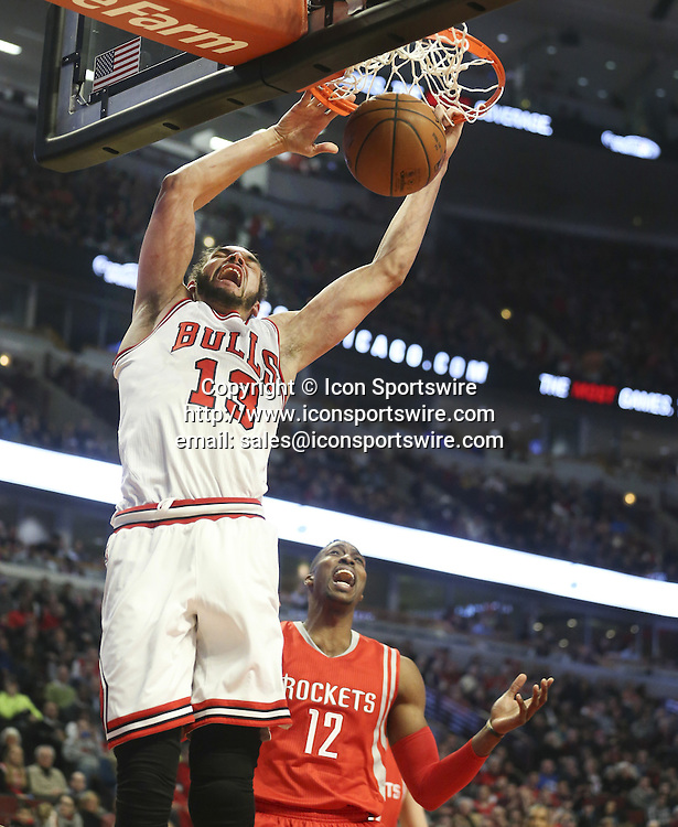 Jan. 5, 2015 - Chicago, IL, USA - Chicago Bulls center Joakim Noah (13) dunks in front of Houston Rockets center Dwight Howard (12) during the first half on Monday, Jan. 5, 2015, at the United Center in Chicago