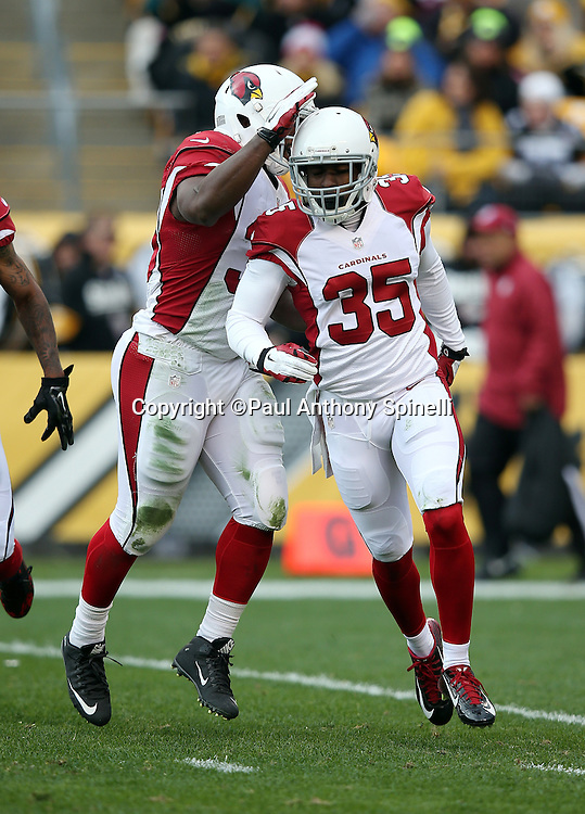 Arizona Cardinals rookie defensive back Cariel Brooks (35) gets a pat on the helmet after stuffing a second quarter kick return by Pittsburgh Steelers running back Dri Archer (13) during the 2015 NFL week 6 regular season football game against the Pittsburgh Steelers on Sunday, Oct. 18, 2015 in Pittsburgh. The Steelers won the game 25-13. (©Paul Anthony Spinelli)