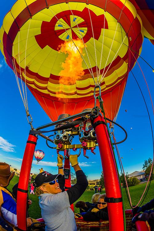 Balloon pilot Gayle Blackaby (Marauder's Mark) after landing in Desert Ridge Trails Park during the Albuquerque International Balloon Fiesta, Albuquerque, New Mexico USA.