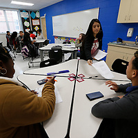Thomas Wells   BUY AT PHOTOS.DJOURNAL.COM<br /> Ilse Acosta, 13, finishes passing out study guides for her math teacher as they enjoy their fist day in their new classrooms at Tupelo Middle School on Tuesday.