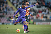 Jordan Botaka (on loan from Leeds United) (Charlton Athletic) takes a shot as Timothee Dieng (Bradford City) watches on during the EFL Sky Bet League 1 match between Bradford City and Charlton Athletic at the Coral Windows Stadium, Bradford, England on 10 December 2016. Photo by Mark P Doherty.
