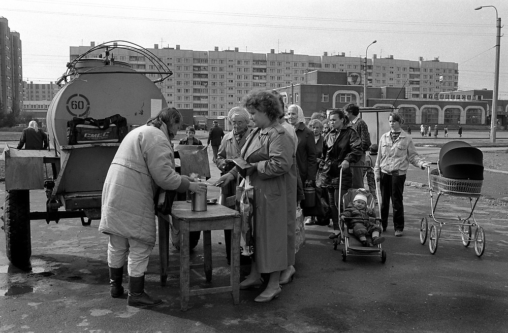 Milk queue.<br /> Not because of lack of milk but because its fresh from farm and cheaper than in shops. Deliveries everyday.<br /> St Petersburg, Russia, 1994