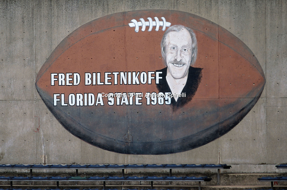 Former Florida State and NFL football Oakland Raiders wide receiver Fred Biletnikoff is honored with a painting on the wall of the high school football field that he played on in his youth on Oct. 8, 1999 in Erie, PA. (©Paul Anthony Spinelli)
