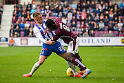 Hearts FC Midfielder Prince Buaben and Kilmarnock FC Defender Kevin McHattie battle during the Ladbrokes Scottish Premiership match between Heart of Midlothian and Kilmarnock at Tynecastle Stadium, Gorgie, Scotland on 3 October 2015. Photo by Craig McAllister.