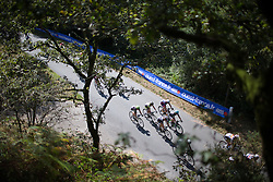 The peloton rolls on one of the fast descents during the 121.5 km road race of the UCI Women's World Tour's 2016 Grand Prix Plouay women's road cycling race on August 27, 2016 in Plouay, France. (Photo by Balint Hamvas/Velofocus)