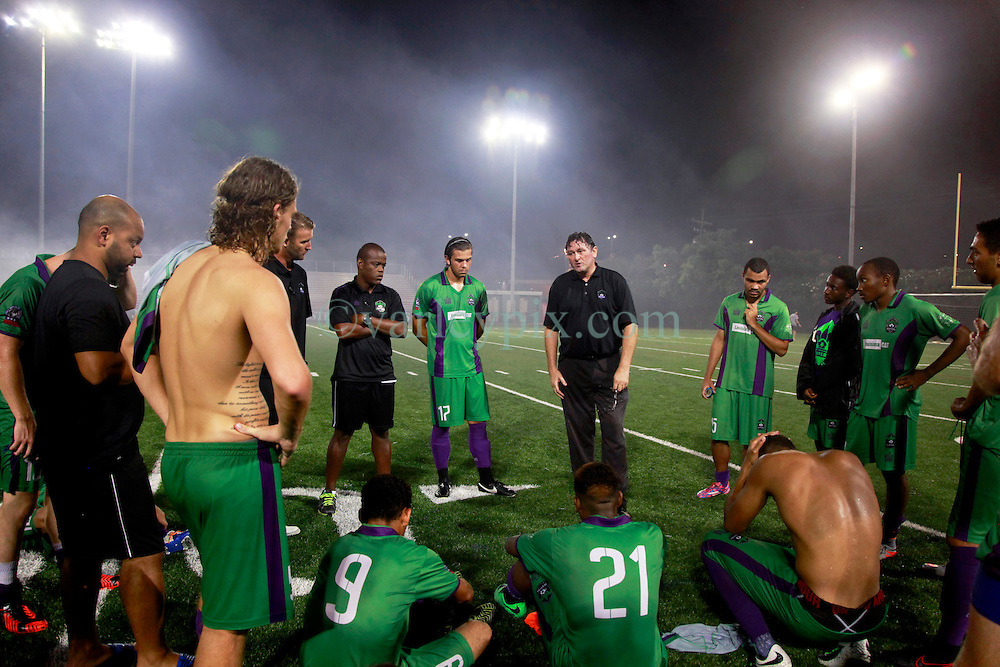 24 June 2015. New Orleans, Louisiana.<br /> National Premier Soccer League. NPSL. <br /> Jesters 0 - Atlanta Silverbacks 1.<br /> Head coach Kenny Farrell of the New Orleans Jesters  gives a team talk following a tough defeat.<br /> Photo&copy;; Charlie Varley/varleypix.com