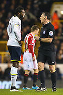 Emmanuel Adebayor of Tottenham Hotspur is booked by Referee, Mr N Swarbrick, during the Capital One Cup Semi-Final 1st Leg match between Tottenham Hotspur and Sheffield Utd at White Hart Lane, London, England on 21 January 2015. Photo by David Horn.