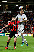 Luke Shaw (23) of Manchester United leaps above Ryan Fraser (24) of AFC Bournemouth to head the ball during the Premier League match between Bournemouth and Manchester United at the Vitality Stadium, Bournemouth, England on 18 April 2018. Picture by Graham Hunt.