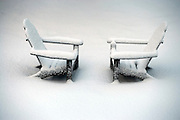 Adirondack chairs in snow.