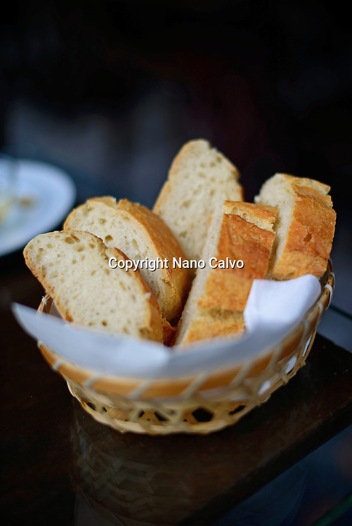 Bread basket on table in restaurant, Granada, Spain