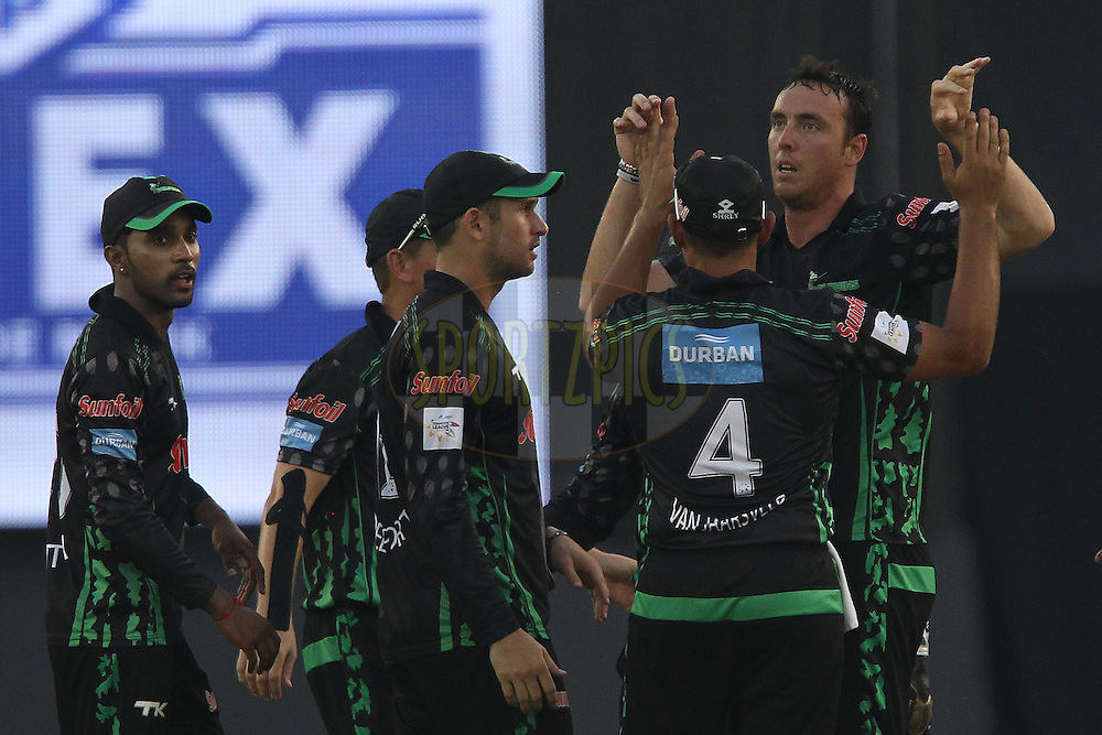 Kyle ABBOTT of the Dolphins  celebrates the wicket of Adam VOGES (Captain) of the Perth Scorchers  during match 4 of the Oppo Champions League Twenty20 between the Dolphins and the Perth Scorchers held at the Punjab Cricket Association Stadium, Mohali, India on the 20th September 2014<br /> <br /> Photo by:  Ron Gaunt / Sportzpics/ CLT20<br /> <br /> <br /> Image use is subject to the terms and conditions as laid out by the BCCI/ CLT20.  The terms and conditions can be downloaded here:<br /> <br /> http://sportzpics.photoshelter.com/gallery/CLT20-Image-Terms-and-Conditions-2014/G0000IfNJn535VPU/C0000QhhKadWcjYs