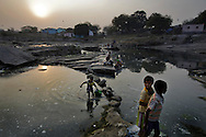 Children play at a polluted river near coal waste dumping site in Dhanbad, Jharkhand, India on Dec 5, 2014.<br /> (Photo by Kuni Takahashi)