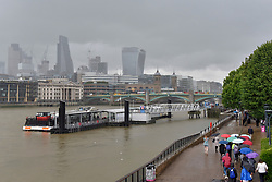 © Licensed to London News Pictures. 11/07/2017. London, UK. Tourists and office workers are caught in a downpour as rain arrives in the capital after several days of hot and dry weather. Photo credit : Stephen Chung/LNP