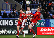 Bolton Wanderers Dennis Politic in action with Harvey Rodgers of Accrington during the EFL Sky Bet League 1 match between Bolton Wanderers and Accrington Stanley at the University of  Bolton Stadium, Bolton, England on 29 February 2020.