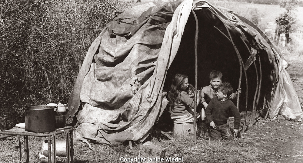 Irish Traveller children in bender tent.