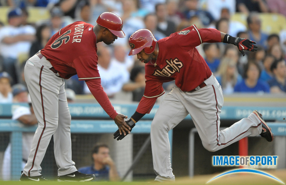 May 31, 2010; Los Angeles, CA, USA; Arizona Diamondbacks center fielder Chris Young (24) is greeted by third base coach Bo Porter (16) after hitting a solo home run in the second inning against the Los Angeles Dodgers at Dodger Stadium.
