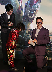 Cast member Robert Downey Jr. goes down on one knee to accept a fan s gift during a promotional event of Hollywood superhero movie Iron Man 3 before its release in China in early May, in Beijing, capital of China, April 6, 2013. Photo by Imago / i-Images...UK ONLY.