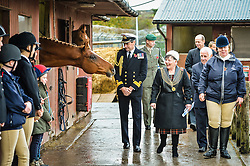 Lord Mayor of Plymouth Pauline Murphy laughs as she passes a horse named Zabor at the Royal Navy and Royal Marines Riding Stables at Bickleigh Barracks, Plymouth, during the first ever memorial service dedicated to horses killed or injured in conflict.