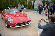 Dance attendees got their photos taken in a 1961 Ferrari before the Shermer High School 1986 Spring Dance that's part of the Ferris Fest at the Athletico Center on, Friday, March 20, 2016, in Northbrook. (Photo by Rob Hart)
