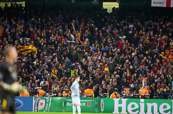 MANCHESTER, ENGLAND - Tuesday, February 18, 2014: FC Barcelona supporters celebrate the second goal against Manchester City during the UEFA Champions League Round of 16 match at the City of Manchester Stadium. (Pic by David Rawcliffe/Propaganda)