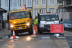 © London News Pictures. 21/10/2017. Aberystwyth, UK. A road closure on the seafront as Storm Brian, the second named storm of the season, with winds gusting up to 70mph, combined with a high Spring tide, bring huge waves crashing into the seafront in Aberystwyth on the Cardigan Bay coast of west wales. Photo credit: Keith Morris/LNP