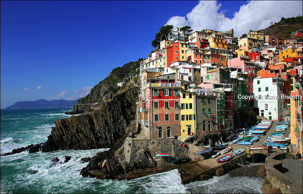 SHOT 3/1/2006 - The town of Riomaggiore in Cinque Terre, Italy. Riomaggiore (Rimas&ugrave;u in the local language) is a village and a commune in the province of La Spezia, situated in a small valley in the Liguria region of Italy. It is the first of the Cinque Terre one meets coming from La Spezia. Riomaggiore, the first city of the Cinque Terre.<br />