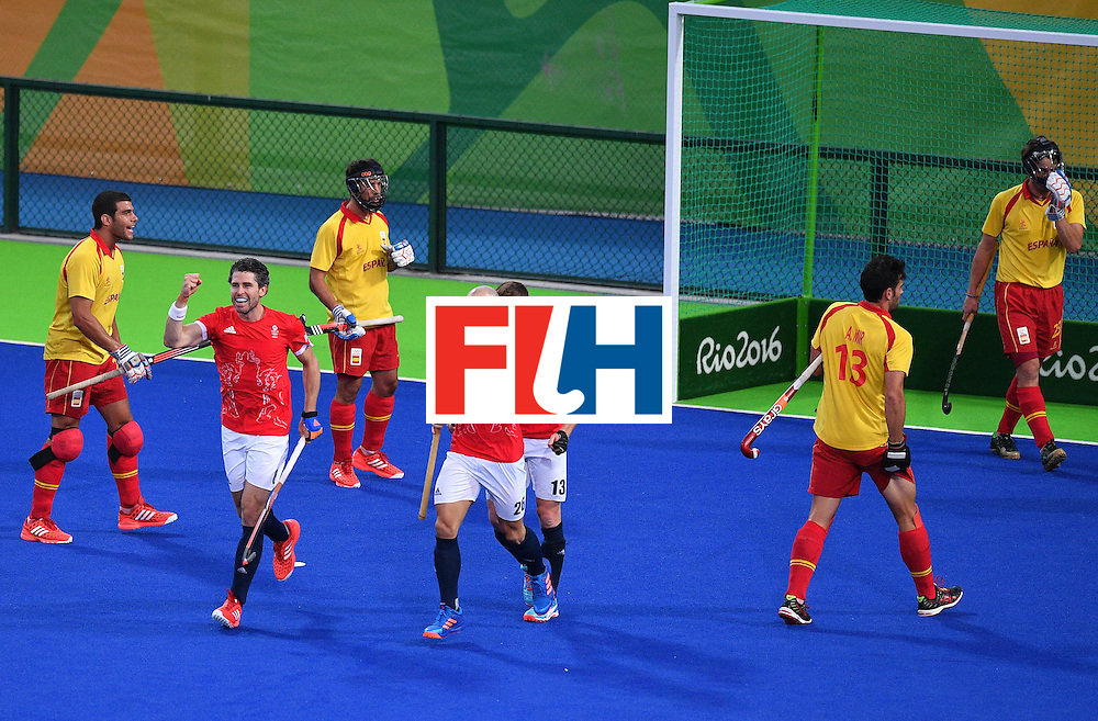 Britain's players celebrate scoring a goal during the mens's field hockey Britain vs Spain match of the Rio 2016 Olympics Games at the Olympic Hockey Centre in Rio de Janeiro on August, 12 2016. / AFP / Carl DE SOUZA        (Photo credit should read CARL DE SOUZA/AFP/Getty Images)