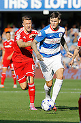 Ben Gladwin looks to advance on the Cardiff Attacking third during the Sky Bet Championship match between Queens Park Rangers and Cardiff City at the Loftus Road Stadium, London, England on 15 August 2015. Photo by Andy Walter.