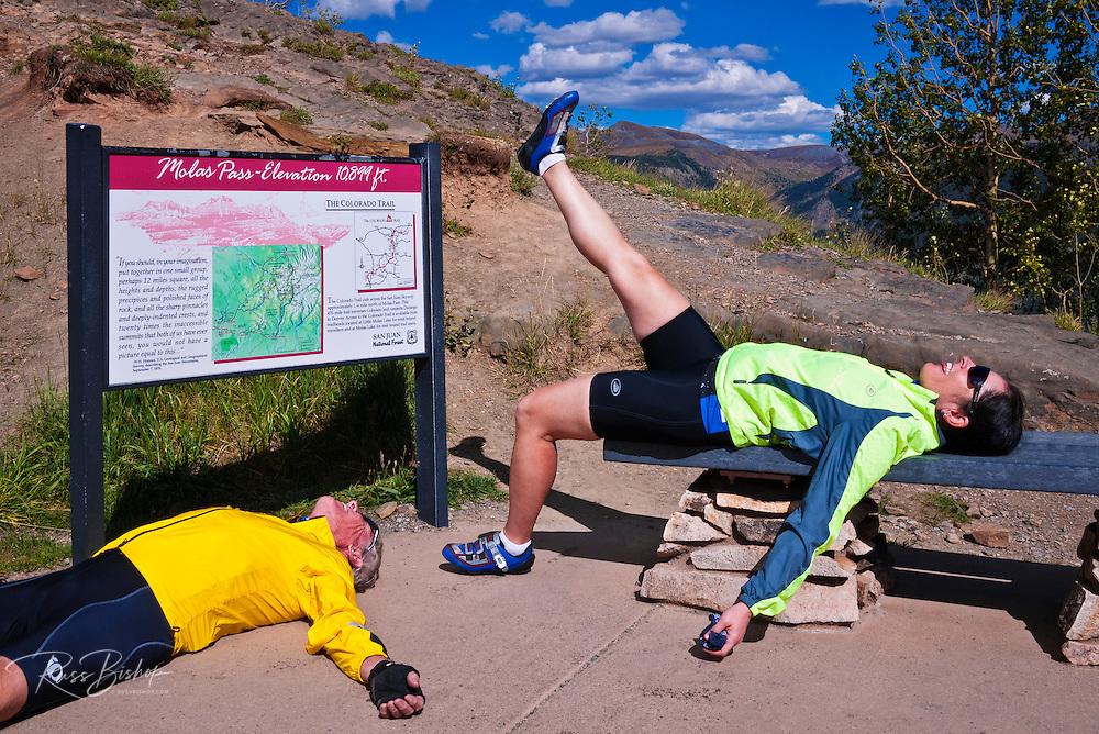 Cyclists goofing off on Molas Pass, San Juan Skyway (Highway 550), San Juan National Forest, Colorado