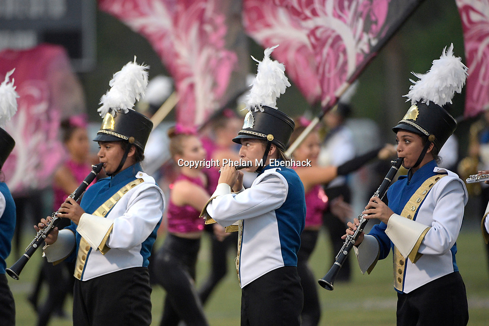 The Lyman color guard and marching band perform before a high school football game against Seminole Friday, Oct. 6, 2017, in Sanford, Fla. (Photo by Phelan M. Ebenhack)