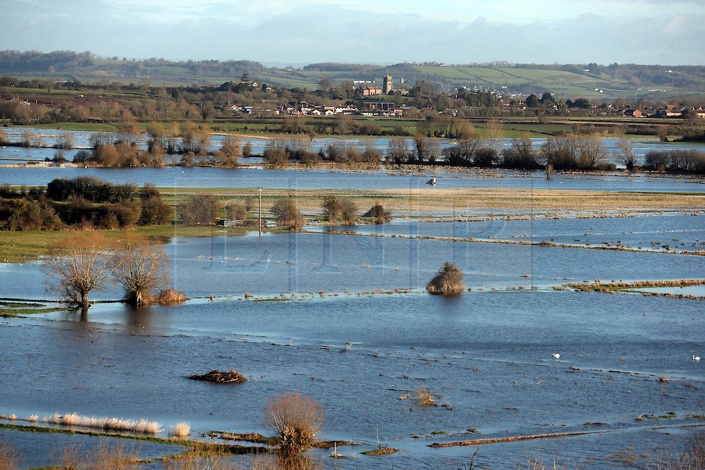 © Licensed to London News Pictures. 07/02/2014.Somerset, UK Floodwaters seen from Burrow Mump in Burrowbridge in Somerset today 7th February 2014. Photo credit : Jason Bryant/LNP