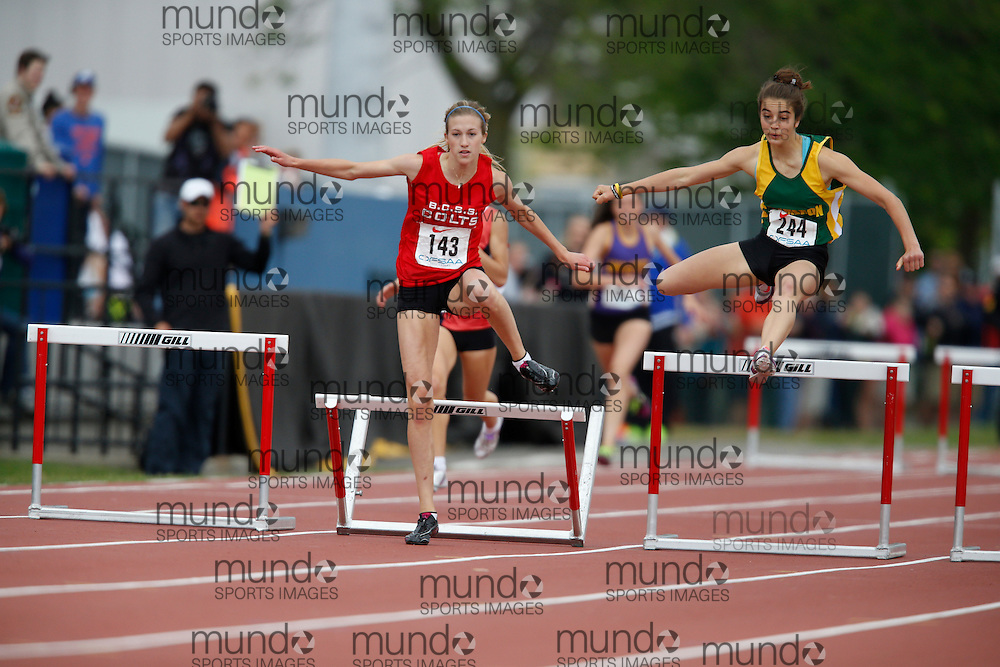 Nicole Skimming of Bill Crothers SS - Unionville competes in the intermediate hurdle finals at the 2013 OFSAA Track and Field Championship in Oshawa Ontario, Saturday,  June 8, 2013.<br /> Mundo Sport Images/ Geoff Robins