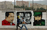 Caracas, Venezuela<br />Murals of Venezuelan president Hugo Chavez (left) with Simon Bolivar to his right and Fidel Castro (far-right) . Large murals depict Chavez alongside other revolutionary leaders have been painted around the Venezuelan capital, notably in poor districts, part of a growing cult of personality centred around Chavez.