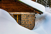 A house covered with deep snow