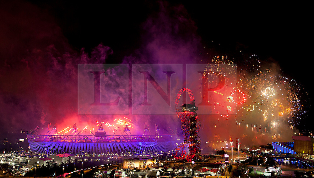 © Licensed to London News Pictures. 28/07/2012. LONDON, UK. Fireworks are seen over the Olympic Stadium during the opening ceremony of the 2012 Summer Olympics in London today (28/07/12). Constituting the third time the Olympic Games have been held in Great Britain, the 2012 Olympic Games, also known as the Games of the XXX Olympiad opened this evening with a show, put together by 'Slum Dog Millionaire' director Danny Boyle, entitled 'The Isles of Wonder. Photo credit: Matt Cetti-Roberts/LNP