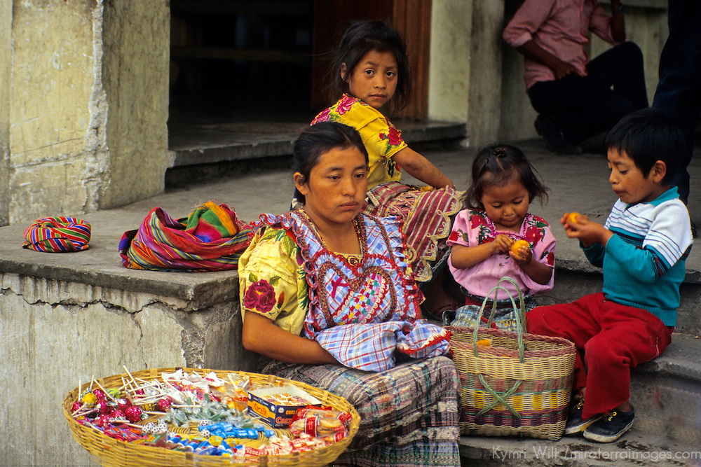 Central America, Guatemala, Antigua. A mother and her children sell candies and sweets on the streets of Antigua, Guatemala.