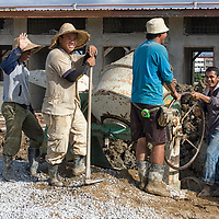 These friendly men were constructing a house in Kuching.